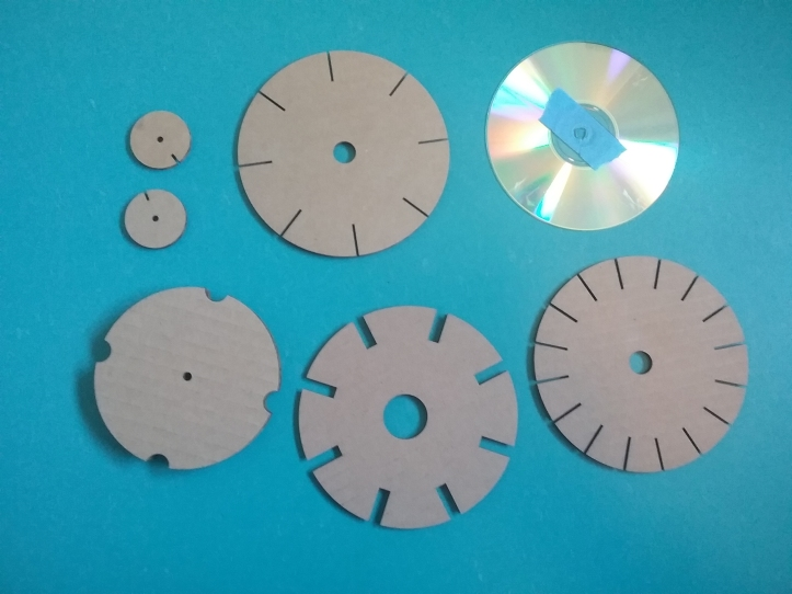 image of 3 cord-making templates and spindle pieces