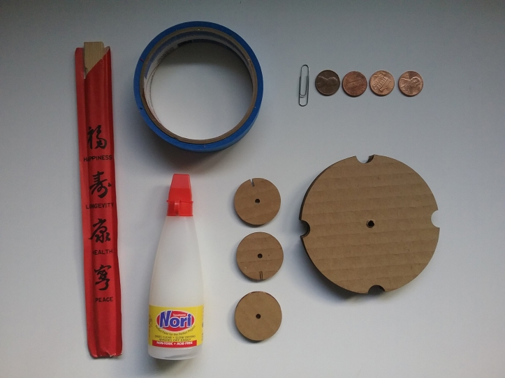image of all pieces and supplies needed for spindle