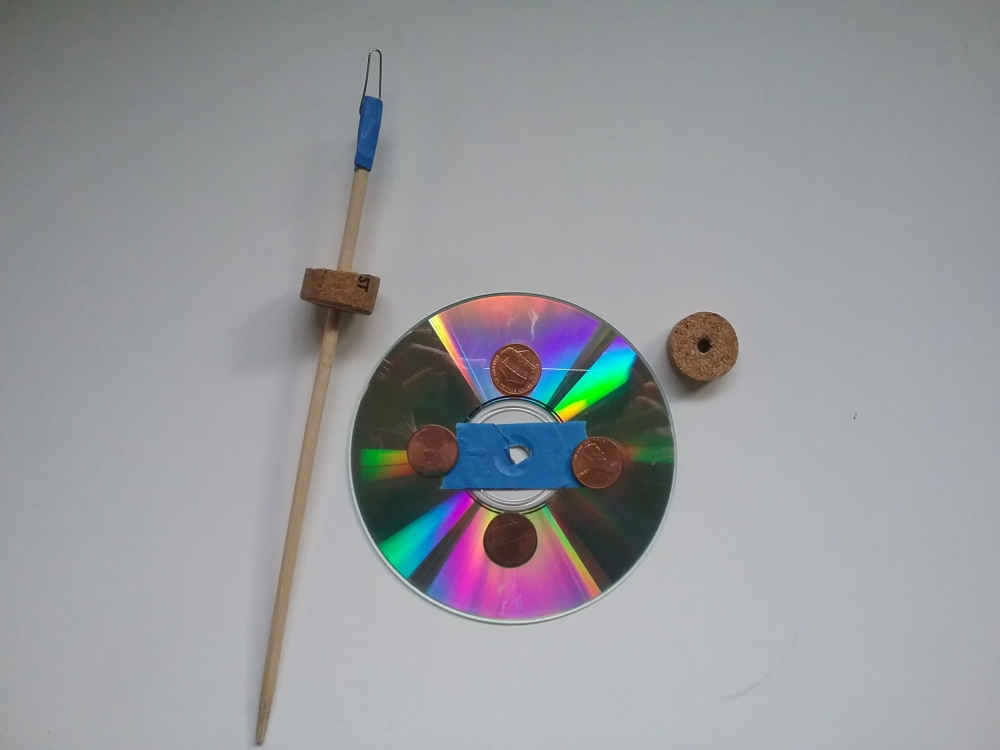 image of adding pennies to the CD for extra weight