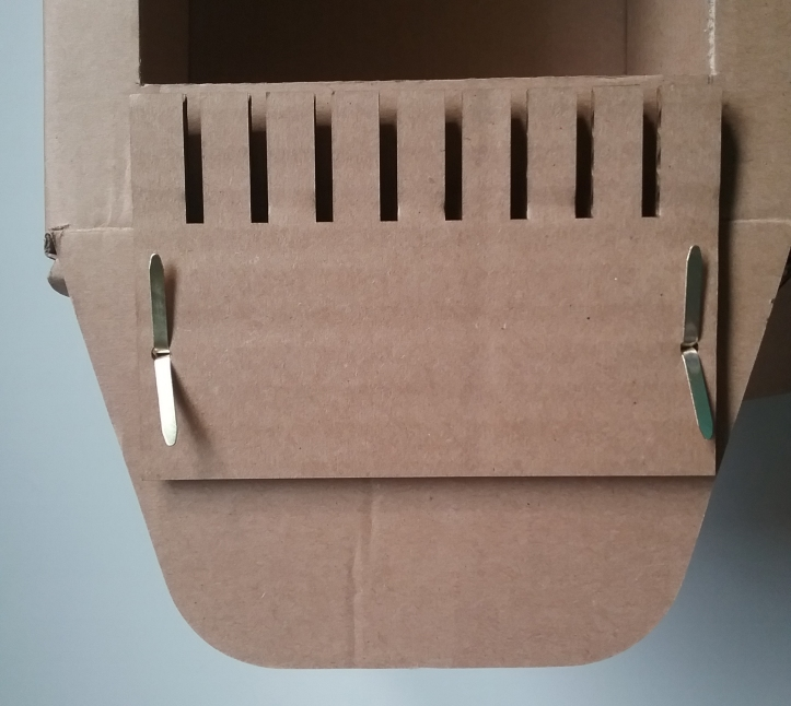 image showing how teeth are fastened to the box with brass brads